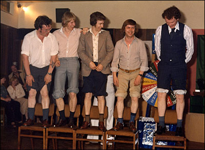 Photograph of male competitors for the knobbly knees competition at The Band Club c 1980.