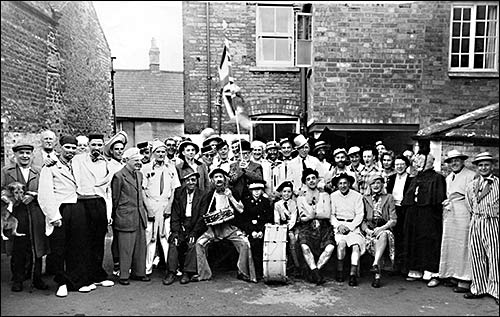 Photograph of the Jockey Regulars in fancy dress in the pub yard c1950