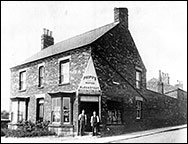 "1927 photograph of Walsh's Off-licence later known as ""The Grapevine""."