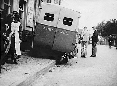 Photograph showing the St John Ambulance Brigade's ambulance in 1938 outside The Red Cow having mounted the pavement after brake failure.
