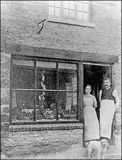 11 Kettering Road, c1920, with Joseph and Sarah Ann Wallis pictured in the doorway