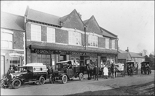 Co-op delivery vehicles in 1926. Wilf Ambler in the white overall.