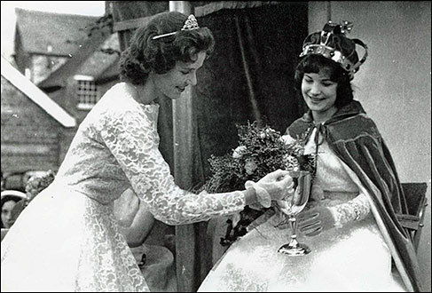 1960 Queen Peggy Hull receives a cup from 1959 Queen Eileen Williamson