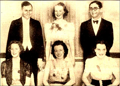 Selection of gala Queens with Judges.  Standing Dr G S Sturtridge, rugby football player and Dr Kessel both of Northampton General Hospital with Miss Sylvia Conroy (Clothing Trade).  Seated L to R: Miss Sylvia Johnson (Shoe & Leather Trade), Miss Irene Tear of Towcester (judge) and Miss Rose Johnson (Other Trades), The Misses Johnson are sisters.