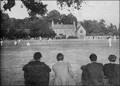 Photograph of Cricket Match with view of The Hall in the backgroundl