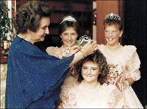 1987 Princess Tania Theobald being crowned by Megan White. The attendants are Louisa Haynes and Laura Newcombe