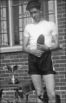 Malcom Craddock with the Arthur Nicholson Trophy. He broke the record for the 100 yards event at the 1949 Kettering & District Schools Sports day.