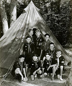 A group outside their tent