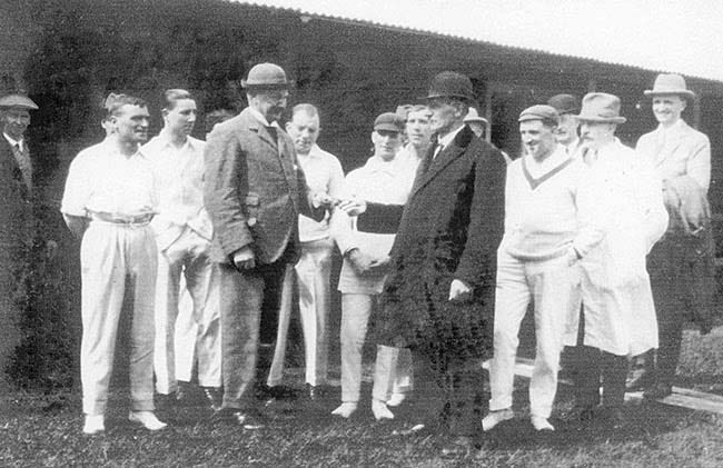 Photo of Burton Town Cricket Club 1930s President, Mr Wilfred T Harpur, handing over key to the club's new pavilion to Mr Bert Fox
