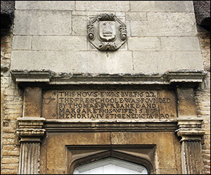Photograph of inscription above central doorway of former Jacobean School