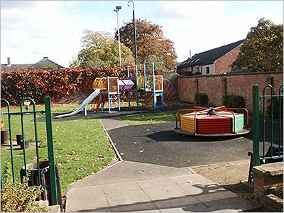 Photograph of Children's Playground showing slide and roundabout