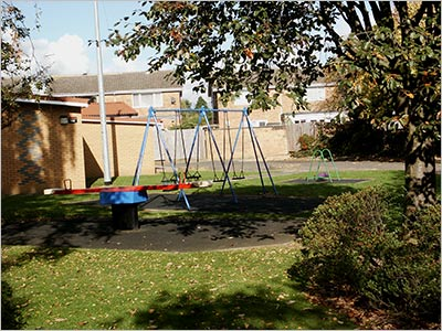 Photograph of Children's Playground showing swings and seesaw