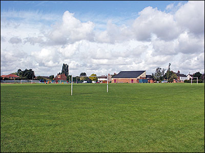 Photograph showing the Recreation Ground with the Community Centre in background