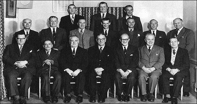 Photograph of members of Burton Latimer Conservative & Unionist Club Ltd on the Golden Jubilee 1912-1962.  Cnr A F Mutlow is shown on the right of the second row