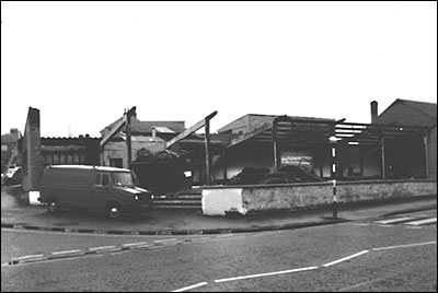 Photograph showing the showroom of Pole Position Cars (formerly Church Street Autos) after a disastrous fire in 1983