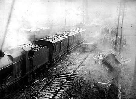 Photographs showing a frieght train derailment on 26 March 1936