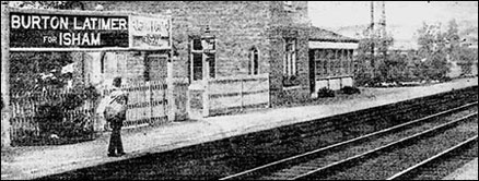Photograph showing the Station Maaster waiting with a mail bag 1923