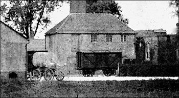 Photograph showing road and rail transport side by side at Wallis's Mill - now Weetabix.