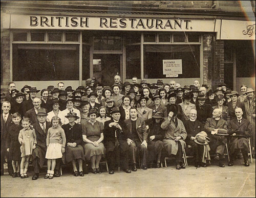 This photograph from 1944 shows a party from the Baptist Church seated outside the British Restaurant in Duke Street.