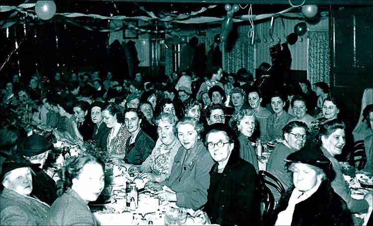 Lady members dinner at the Band Cllub 1952.  Some names from the nearest table: Mrs Barclay, June Smith and Mrs Jack Smith.  Some with their backs to the camera on the next table are: 2nd Mrs Austin and three places along, Mrs Capps.  Facing the camera on that table are: Mrs Borman, Janet Craddock, Sheila Fennell and next but one, Maud Bunyan.