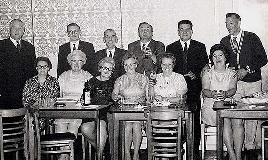 Social Event 1970s Standing L-R: Fred Wells, Dennis Crick, Tom Barber, ? Jack Craddock, ?,  Seated L-R: Gladys Wells, Josie Crick, Gwen Twelvetree, Evelyn Barber, Janet Craddock, ?.