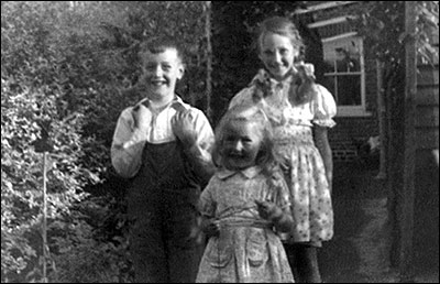 Neville Sumpter pictured in 1942 at Station Road with cousins Angela (older) and Pamela (younger) in 1942.