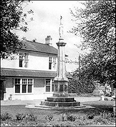 Photograph of the War memorial located in front of The Poplars